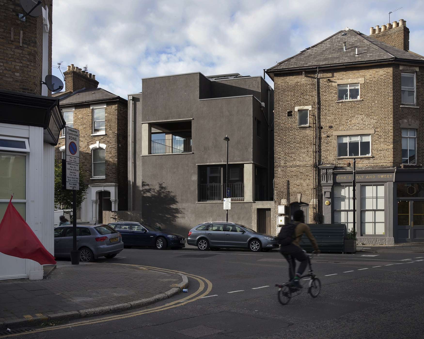 6a architects black stone building for Black stone house